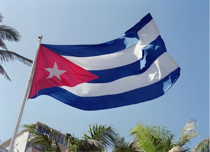 Cuban flag flutters freely in the wind against azure sky