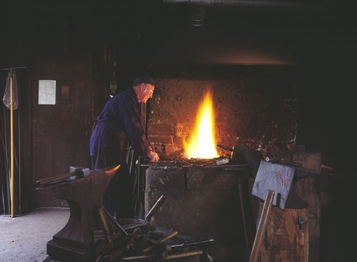 Blacksmith working indoors