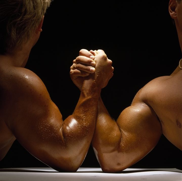 Close-up of two men arm wrestling