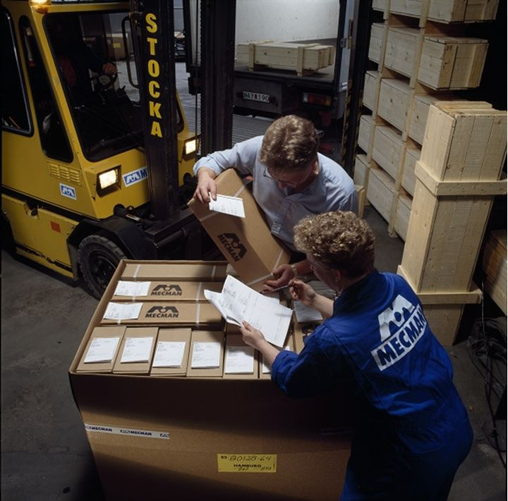 Two people working in a warehouse