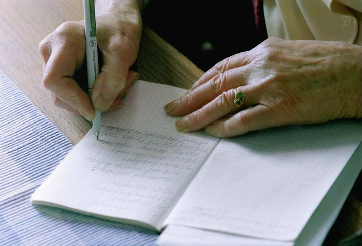 An old woman writing tockholm 1995