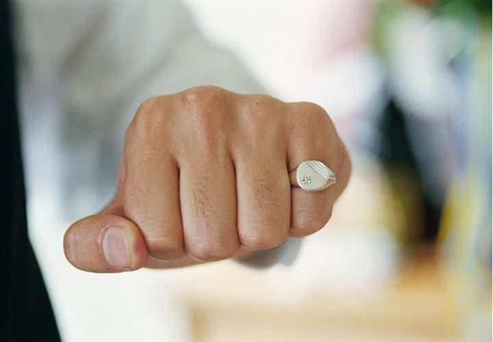 A fist with a ring on one finger Stockholm 1996