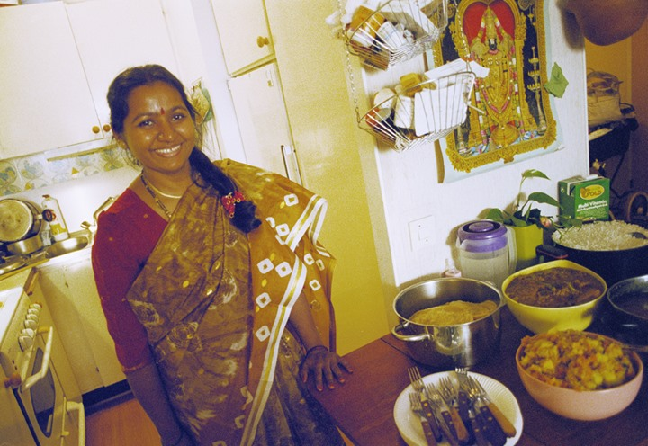 Indian woman in her kitchen in Stockholm