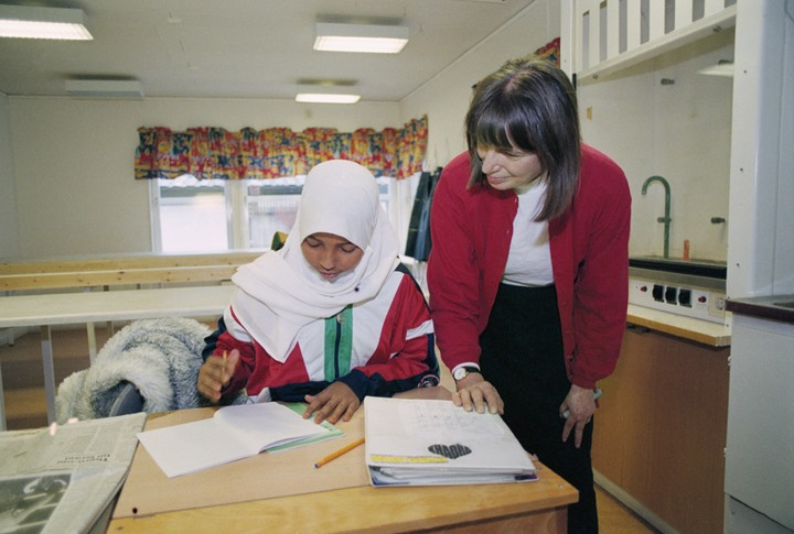 Teacher with pupil in a Moslem school in Stockholm 1997