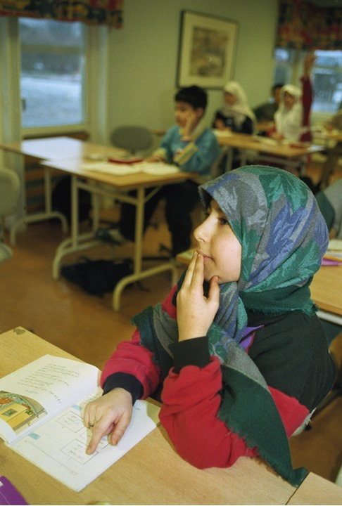 Girl listening to the teacher in a muslim school in Stockholm 1997