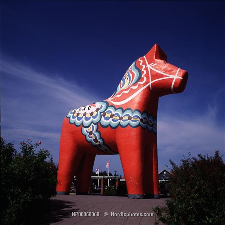 A giant red toy horse