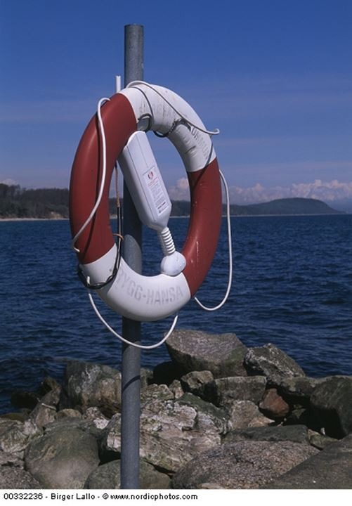 Life buoy hanging on a pole on the seashore