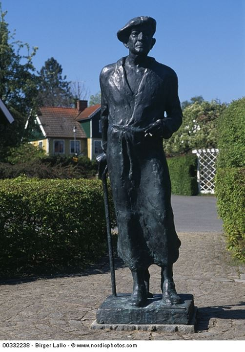 Close-up of a statue and houses in the background