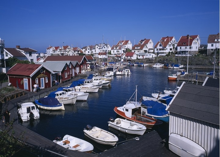 High angle view of houses and boats moored on harbour