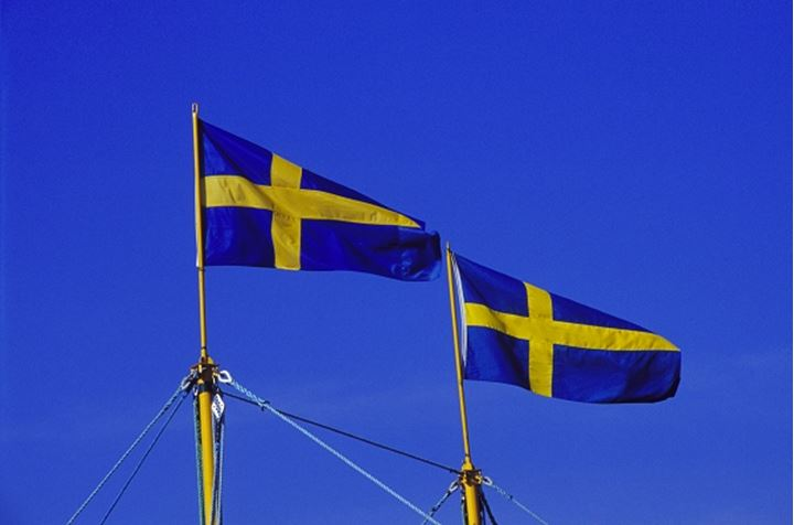 Swedish flags waving against the blue sky