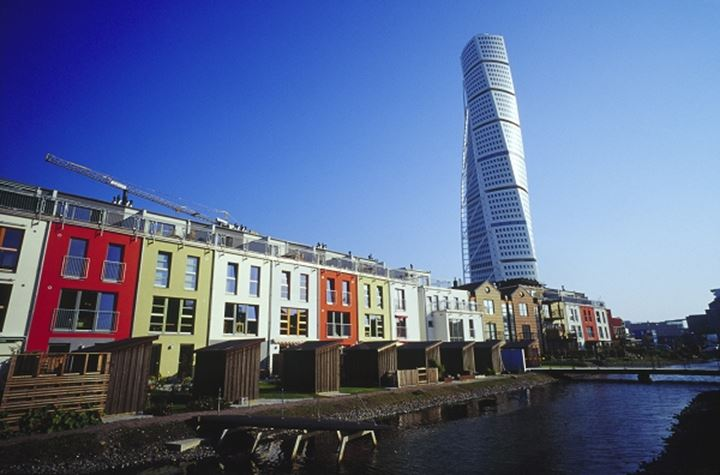 Turning Torso and houses in row on the bank of river