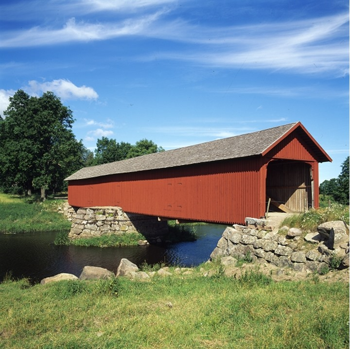 A red bridge with trees, Valholm, Norway