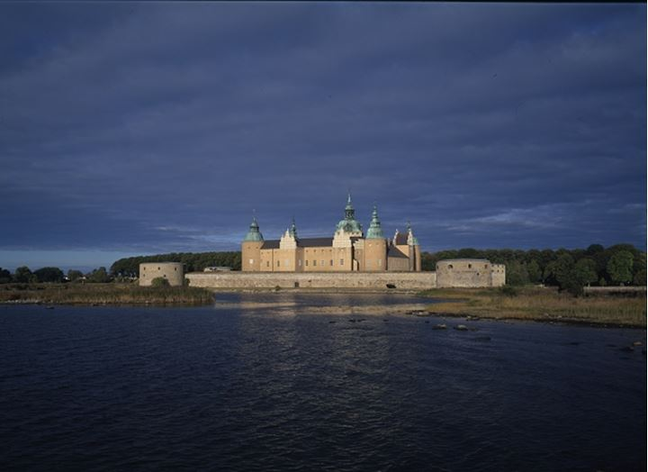 A castle with cloudy sky and river
