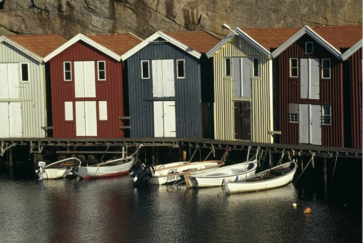 Boats by boathouses