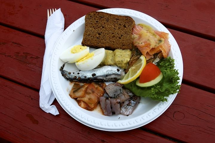 High angle view of fish with eggs and ham in a plate