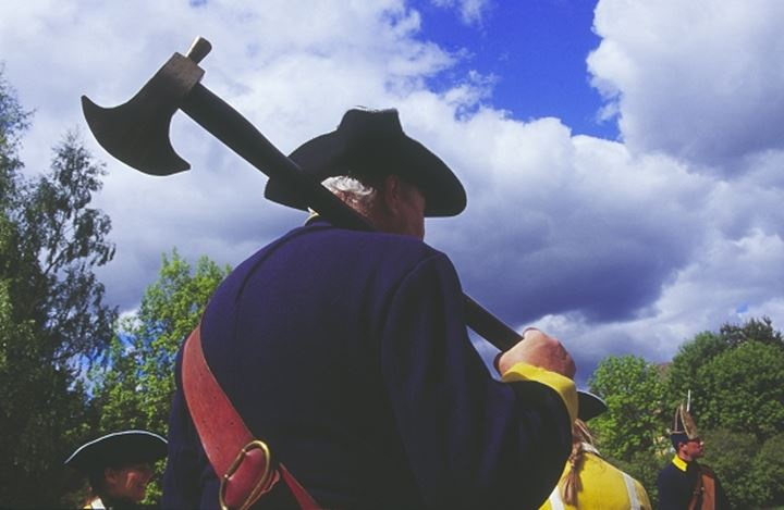 Low angle view of a person holding axe