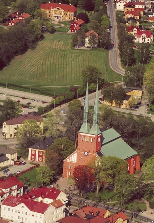 High angle view of building and houses in a town