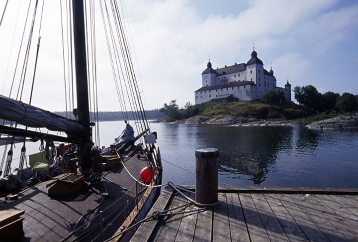 Lacko castle, on lake Vanern,  Sweden.  Boat in the marina in foreground.