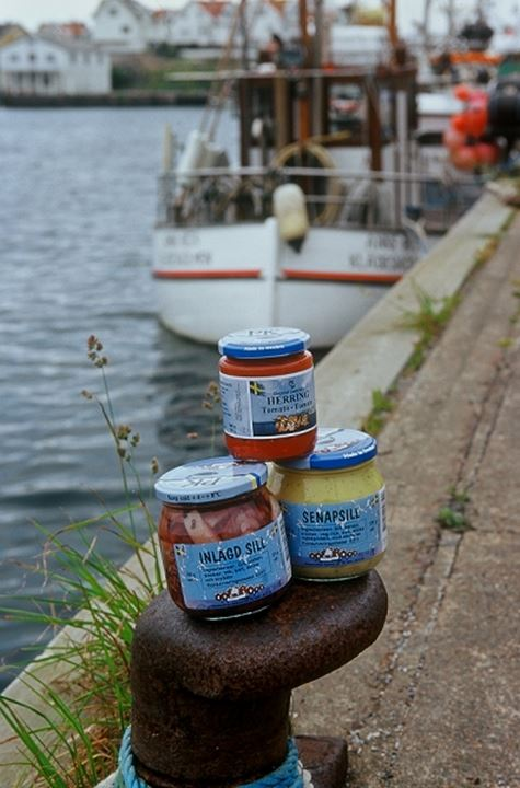 Three food jars with boat by the river