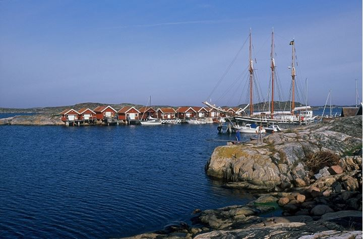 Homes with sailboats and blue sky, Sweden.