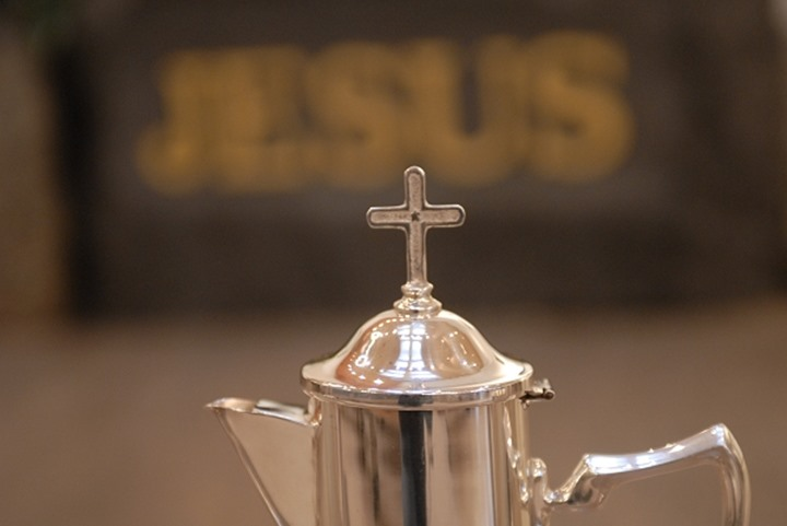 Close up view of a crucifix on the kettle