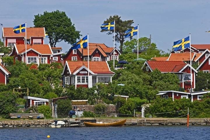 Houses with swedish flags, Stockholm, Sweden