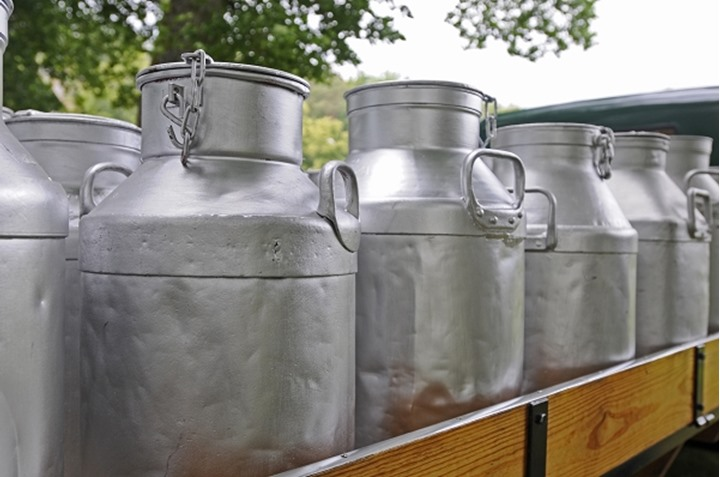 Milk canisters on a truck