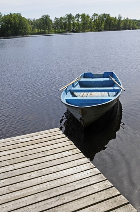 Boat in front of a small jetty,  Smaland, Sweden