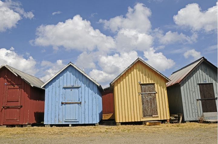 Beach huts in a row on the beach, Sweden