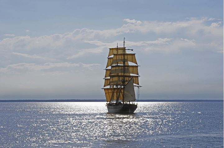 The brig Tre Kronor sailing, distant land ahead, Sweden.