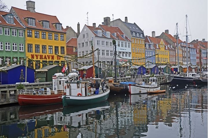 Boats on the canal decorated for christmas, Nyhavn, Copenhagen, Denmark.