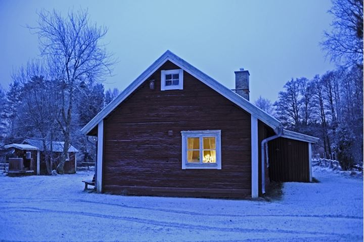 Rural house at dusk, Smaland, Sweden.