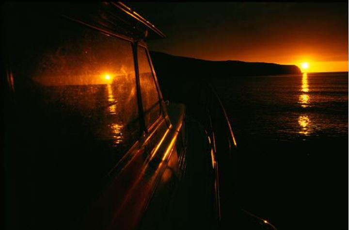 Reflection of sunset on a boat's window
