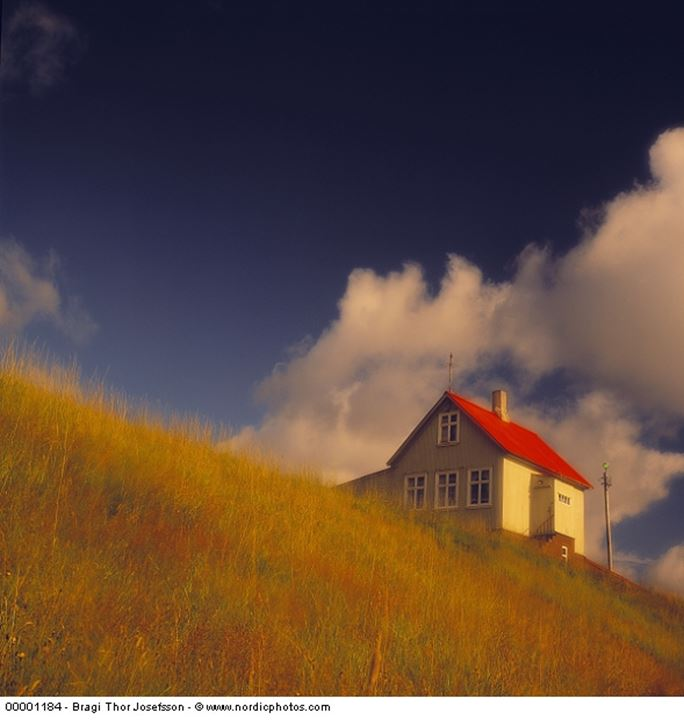 A house standing on a hills of Ellidardalur in Reykjavik by sunset