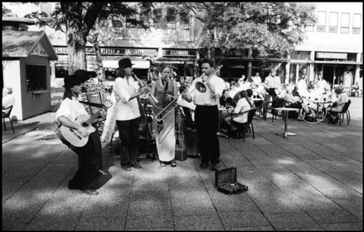 Musicians playing beside an outdoor cafe