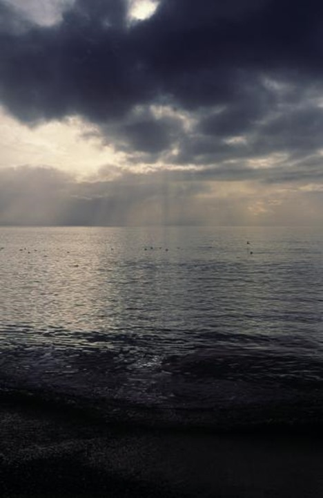 Black clouds over the ocean