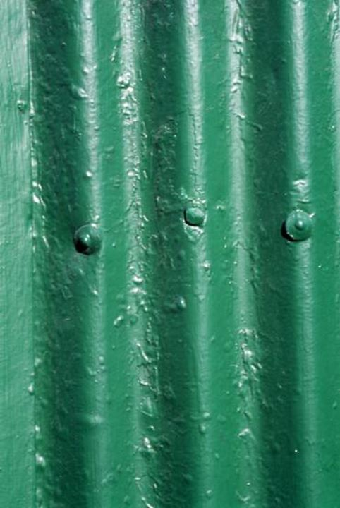 Close up of a green painted iron