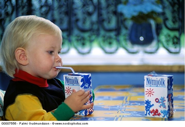Toddler drinking milk with a straw