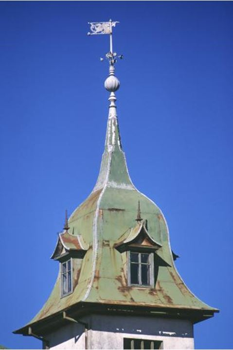 The tower of an old house and a blue sky