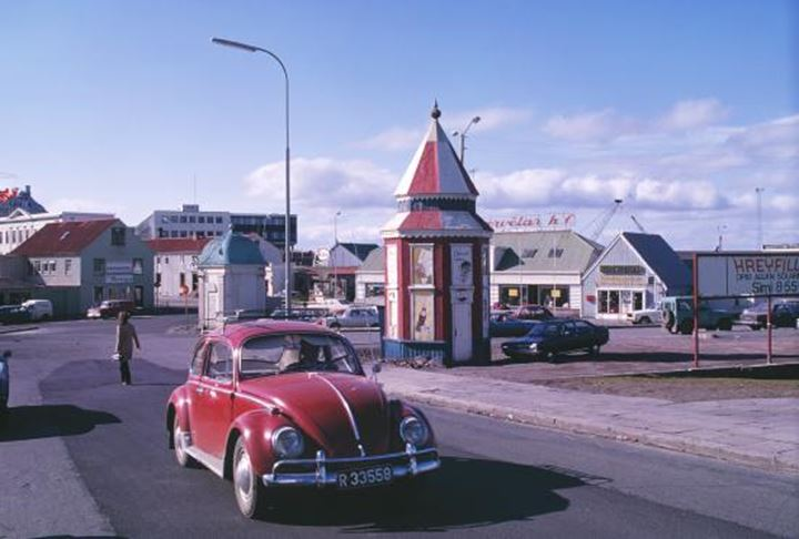 An old car driving downtown Reykjavík around 1975