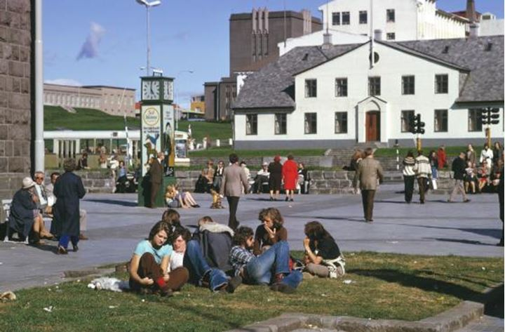 People sitting at Lækjartorg downtown in Reykjavik in the summertime