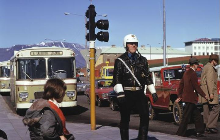 Reykjavik in the early 80´s, buses at the bus station and a policeman monitoring traffic.