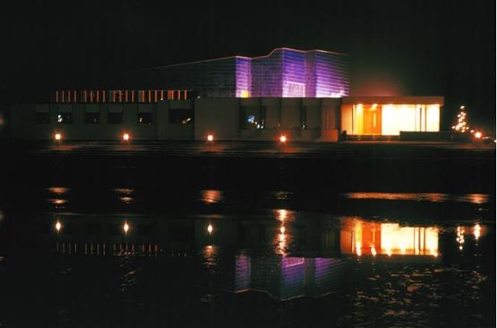 The Nordic house illuminated at night time