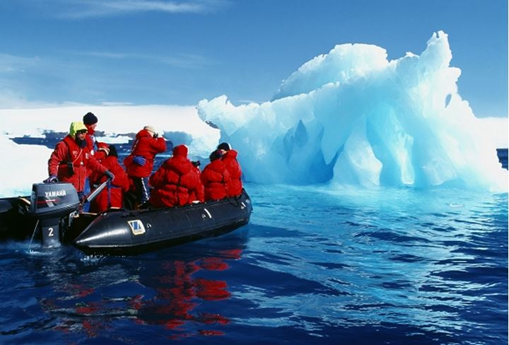 Tourists looking at a great iceberg