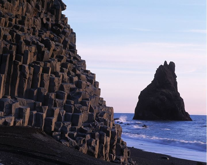 Iceland - Columnar basalt and a cliff in the sea