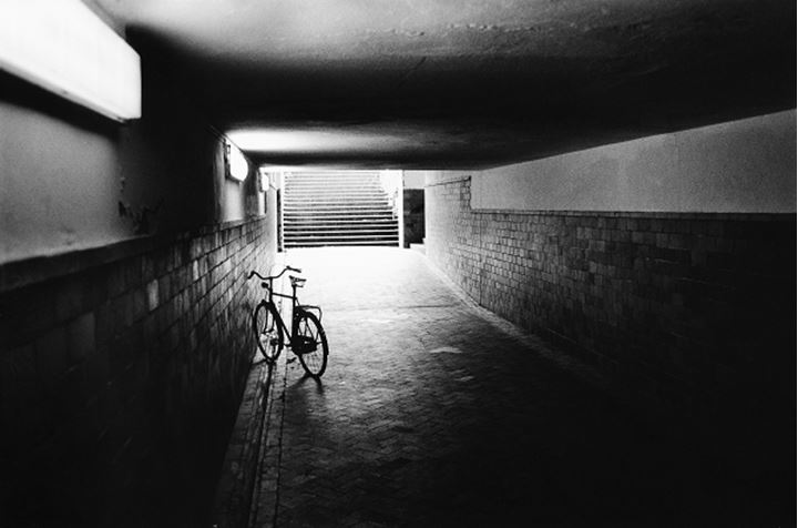 Bicycle in an underpass and daylight falling down the steps, Copenhagen Denmark