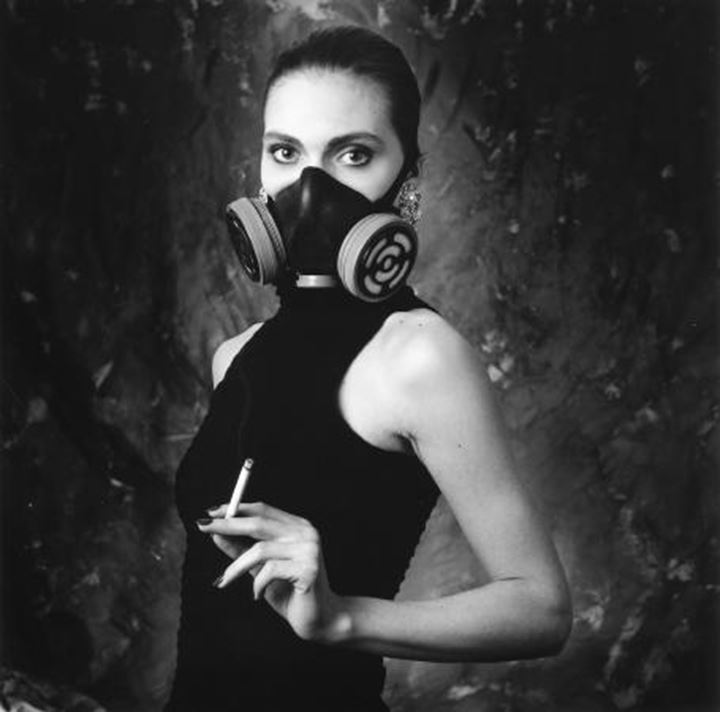 Portrait of a woman wearing a mask and holding a cigarette, Iceland