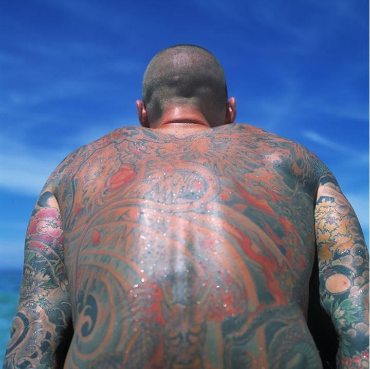 Back of a man covered with tattoos