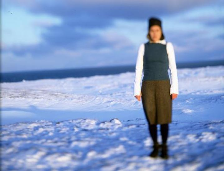Blurred sight of a woman standing in snow