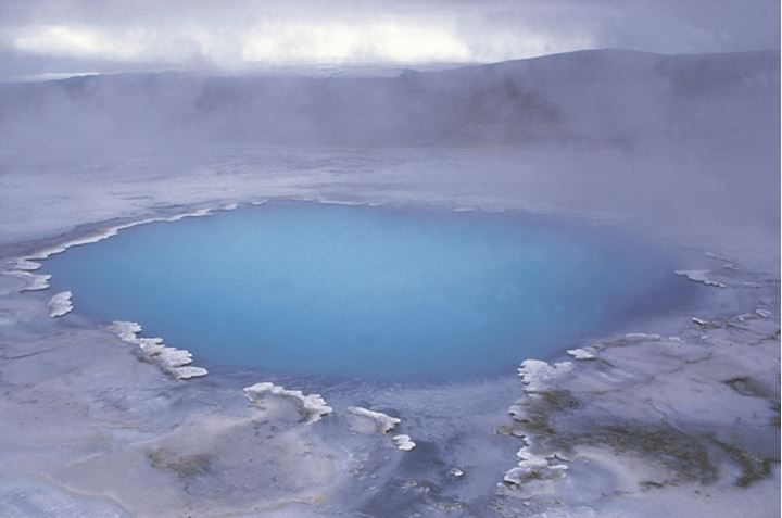 A geothermal hot spring, steam above it